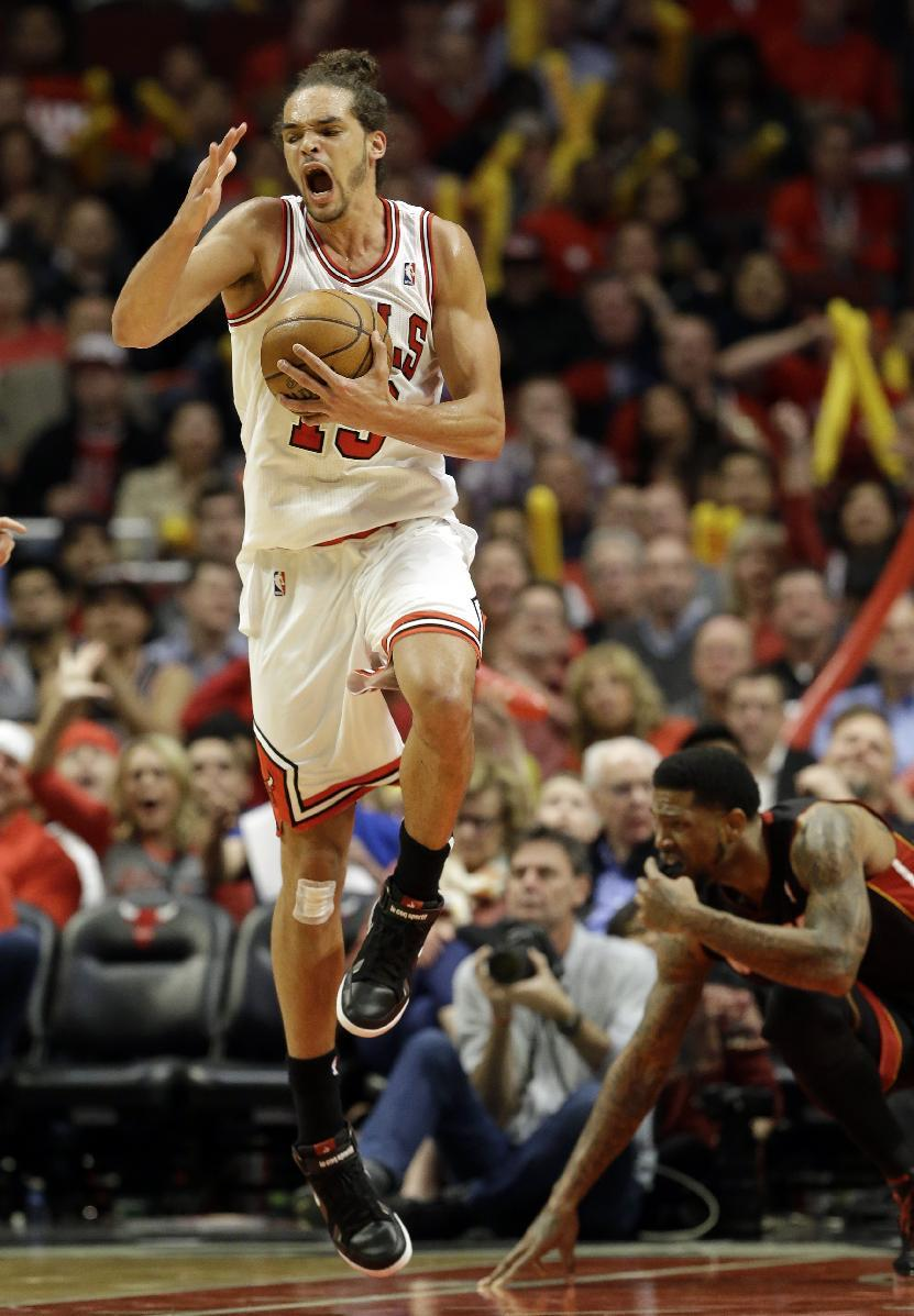 Chicago Bulls center Joakim Noah reacts during the second half of Game 4 of an NBA basketball playoffs Eastern Conference semifinal against the Miami Heat on Monday, May 13, 2013, in Chicago. (AP Photo/Nam Y. Huh)
