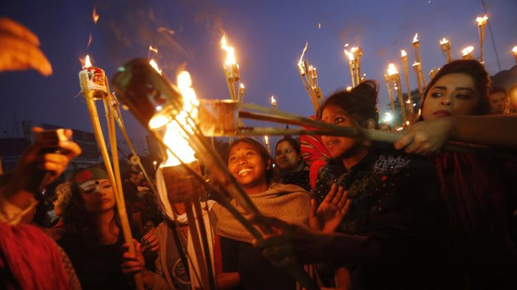 People take part in a torch-lit rally as they celebrate Supreme Court decision on Mollah in Dhaka
