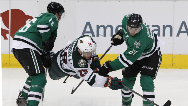 Dallas Stars left wing Ryan Garbutt (16) and Antoine Roussel (21) vie with Minnesota Wild right wing Jason Pominville (29) for the puck in the third period during an NHL hockey game in Dallas on Saturday, March 8, 2014. The Stars won 4-3. (AP Photo/ Richard W. Rodriguez)