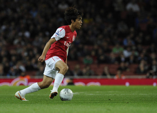 Arsenal's Ju Young Park runs with the ball during their English League Cup soccer match against Shrewsbury Town at the Emirates stadium, London, Tuesday, Sept. 20, 2011. (AP Photo/Tom Hevezi)
