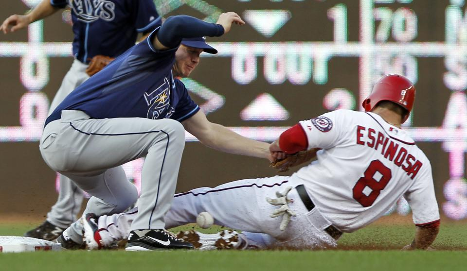 Washington Nationals' Danny Espinosa (8) is safe at second on a steal as Tampa Bay Rays shortstop Elliot Johnson can't handle the throw during the first inning of a baseball game at Nationals Park on Tuesday, June 19, 2012 in Washington. (AP Photo/Alex Brandon)