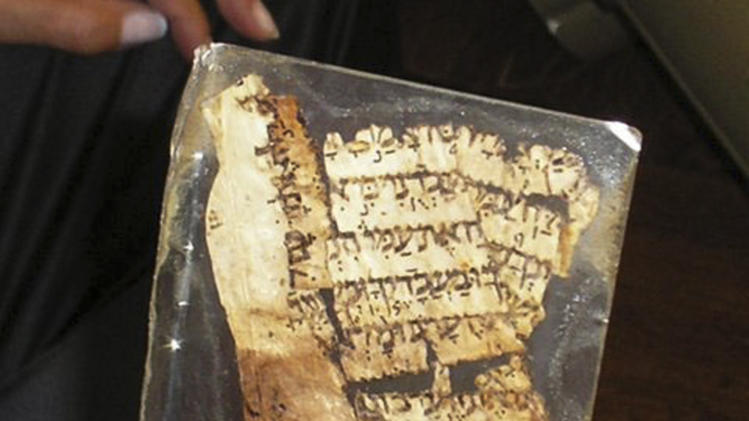 FILE - This undated file photo made available by the Yad Ben Zvi Institute on Nov. 8, 2007, shows a piece of an ancient parchment believed to be part of the most authoritative manuscript of the Hebrew Bible, the Aleppo Codex. Software developed by an Israeli team of scholars led by Moshe Koppel, of Bar Ilan University near Tel Aviv, is giving intriguing new hints about what researchers believe to be the multiple hands that wrote the Bible. (AP Photo/Yad Ben Zvi Institute, File) NO SALES