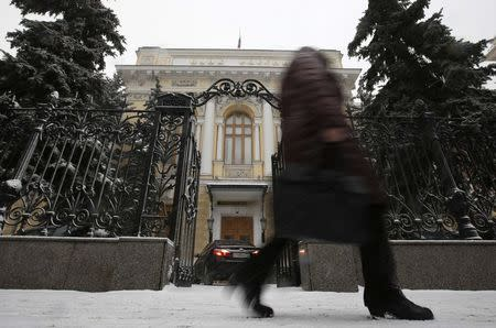 A pedestrian walks past the Central Bank headquarters in Moscow