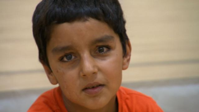 Afghan boy blinded in attack regains his sight and his childhood