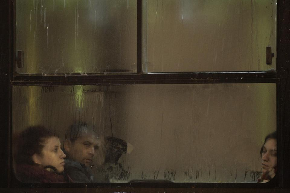 Passengers look through a window of a bus during a heavy rainfall  in central Athens,on Monday, Feb. 6, 2012. Authorities in northeastern Greece announced the voluntary evacuation of people in flood-stricken villages on the Turkish border. (AP Photo/Petros Giannakouris)