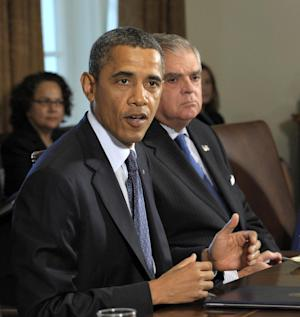 FILE - In this Oct. 3, 2011, file photo, President Barack Obama gestures during a Cabinet meeting at the White House in Washington, as Transportation Secretary Ray LaHood watches. LaHood will leave the Obama administration at the end of the president's current term, his top spokeswoman said Thursday, Oct. 13, 2011. (AP Photo/Susan Walsh, File)
