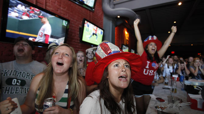 Anne Waldrop, left, of Paducah, Ky., Sam Penico, center, of Alexandria, Va., and Lauren Rachal, of Arlington, Va., react as they watch television coverage in the first half of the Women's World Cup soccer final in Germany between Japan and the United States, at Public Bar in Washington, on Sunday, July 17, 2011. (AP Photo/Jacquelyn Martin)