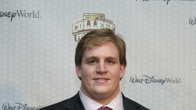 Alabama's Barrett Jones holds the Outland Trophy given to the nation's most outstanding interior lineman during the College Football Awards show in Lake Buena Vista, Fla., Thursday, Dec. 8, 2011. (AP Photo/Phelan M. Ebenhack)