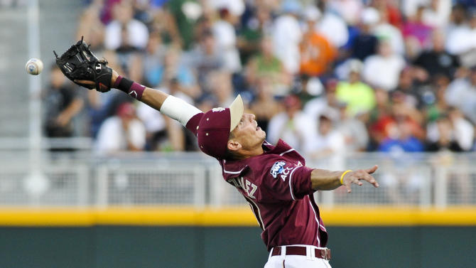 Florida State shortstop Justin Gonzalez can't reach the ball, hit for a single by UCLA's Beau Amaral, in the fourth inning of an NCAA College World Series elimination baseball game in Omaha, Neb., Tuesday, June 19, 2012. (AP Photo/Eric Francis)