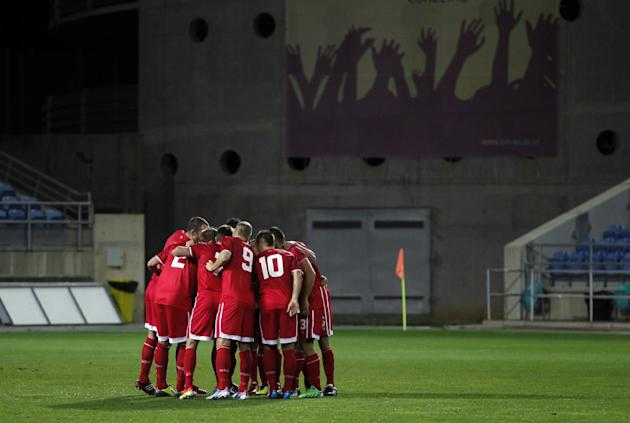 Gibraltar's players gather before the start of a friendly soccer match between Gibraltar and Slovakia at the Algarve stadium in Faro, southern Portugal, Tuesday, Nov. 19, 2013. Gibraltar played its fi