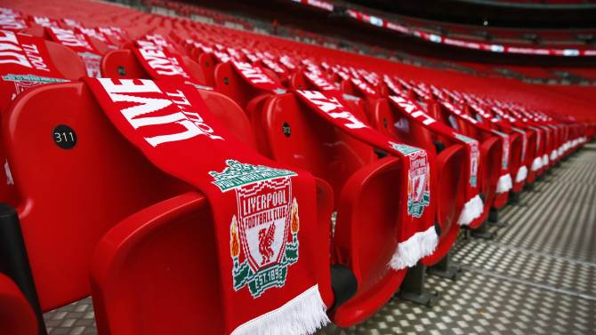 Ninety-six Liverpool scarves are placed on seats on the 25th anniversary of the Hillsborough disaster before the FA Cup semi-final soccer match between Arsenal and Wigan Athletic at Wembley Stadium in London