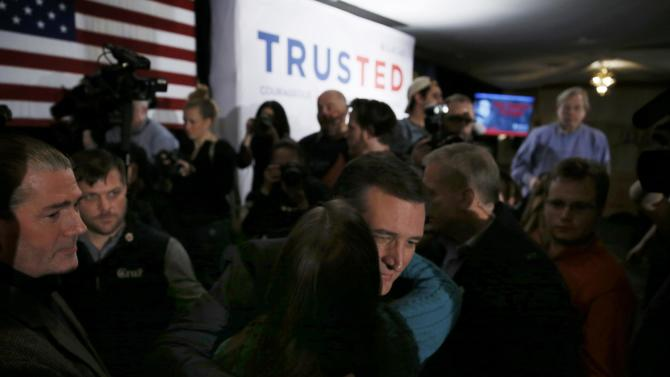 Republican U.S. presidential candidate Ted Cruz is greets by a supporter at his 2016 New Hampshire primary night rally in Hollis, New Hampshire