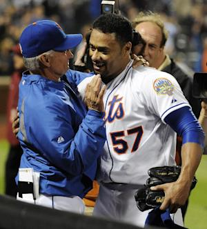 New York Mets starting pitcher Johan Santana (57) hugs manager Terry Collins after he threw a no-hitter against the St. Louis Cardinals in a baseball game on Friday, June 1, 2012, at Citi Field in New York. The Mets won 8-0. (AP Photo/Kathy Kmonicek)
