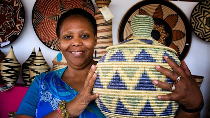 This undated image, provided by the International Folk Art Market, shows Janet Nkubana of the Gahaya Links Cooperatives in Rwanda, at the International Folk Art Market in Santa Fe, N.M. This year's market begins July 10, 2015. (Judith Cooper Haden/International Folk Art Market via AP)