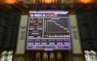 <p>Photo shows the Ibex 35 index at Madrid's stock exchange, on July 20. A eurozone bailout for Spain's banks and a tough batch of pay cuts and tax hikes have not been enough to save the country from the risk of a full-blown bailout, analysts warn.</p>