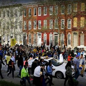 Protests grow after Baltimore man's death in police custody