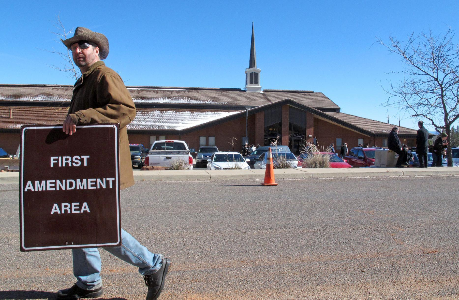 The Latest: Mourners fill pews for Oregon occupier's funeral