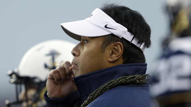 Navy head coach Ken Niumatalolo meets with players during a timeout in the first half of an NCAA college football game against Army Saturday, Dec. 8, 2012, in Philadelphia. (AP Photo/Matt Rourke)