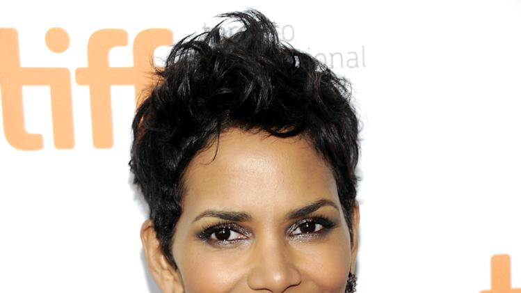 """Actress Halle Berry attends the premiere of """"Cloud Atlas"""" during the Toronto International Film Festival on Saturday Sept. 8, 2012 in Toronto. (Photo by Evan Agostini/Invision/AP)"""