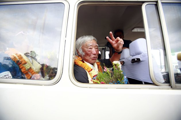 Japanese mountain climber Yuichiro Miura, 80, shows a victory sign upon his arrival at the airport after climbing Mount Everest, in Kathmandu