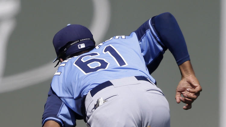 Tampa Bay Rays second baseman Cole Figueroa (61) grabs a ball hit by Boston Red Sox Dustin Pedroia to throw him out at first in the inning of an exhibition baseball game in Fort Myers, Fla., Monday, March 10, 2014