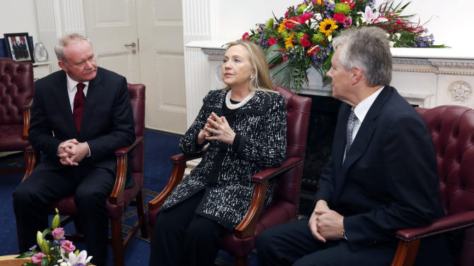 U.S. Secretary of State Hillary Rodham Clinton, centre,  meets with Northern Ireland's First Minister Peter Robinson, right, and Deputy First Minister Martin McGuinness, left, at Stormont Castle in Belfast, Northern Ireland, Friday,  Dec. 7, 2012. Clinton travelled to Northern Ireland on Friday to lend her support to the British province's fragile peace, the frailty of which was underlined by overnight rioting on the eve of her visit and the seizure of a bomb. (AP Photo, Kevin Lamarque, Pool)