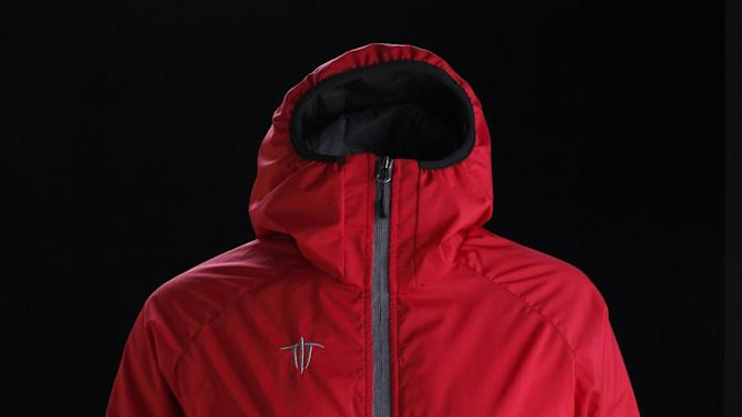 This product image released by Wild Things shows a women's Insulight jacket, featuring an insulated hood. (AP Photo/Wild Things)