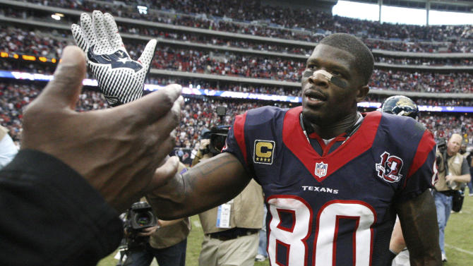 Houston Texans wide receiver Andre Johnson is congratulated as he leaves the field after an NFL football game against the Jacksonville Jaguars Sunday, Nov. 18, 2012, in Houston. Johnson scored the winning touchdown in their 43-37 overtime win. (AP Photo/Patric Schneider)