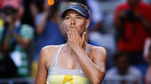 Maria Sharapova of Russia blows kisses to the crowd after defeating Misaki Doi of Japan during their women's singles match at the Australian Open tennis tournament in Melbourne (Reuters)