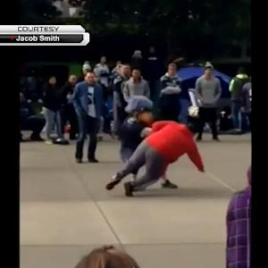 Seattle Seahawks mascot jukes San Francisco 49ers fan