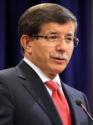 Turkish Foreign Minister Ahmet Davutoglu speaks to the media in Ankara, Turkey, Friday, Sept. 2, 2011. Turkey said Friday it was expelling the Israeli ambassador and cutting military ties with Israel over the last year's deadly raid on a Gaza-bound aid flotilla.  Davutoglu said Turkey was downgrading diplomatic ties to the level of second secretary and that the ambassador and other high-level diplomats would leave the capital Ankara by Wednesday.(AP Photo)