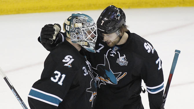 San Jose Sharks goalie Antti Niemi (31), of Finland, is congratulated by teammate defenseman Brad Stuart (7) after a 2-1 victory against the Los Angeles Kings in Game 6 of their second-round NHL hockey Stanley Cup playoff series in San Jose, Calif., Sunday, May 26, 2013. (AP Photo/Tony Avelar)