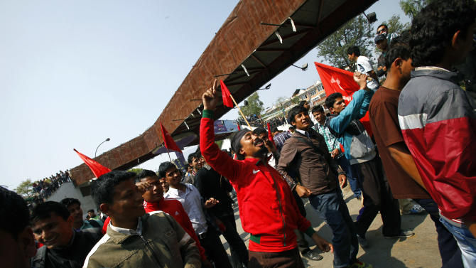 Members of a splinter faction of the Unified Communist Party of Nepal Maoist shout slogans as they protest against the formation of an interim government in Katmandu, Nepal, Thursday, March 14, 2013. Nepal's chief judge Khilraj Regmi was named head of an interim government Thursday in an attempt by the Himalayan country's main political parties to cure the paralysis and infighting that have blocked elections for months. (AP Photo/Niranjan Shrestha)