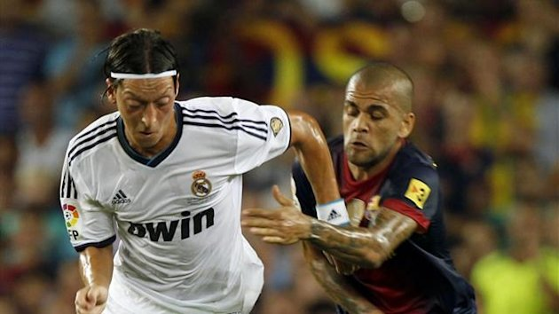 ozil alves real madrid barcelona