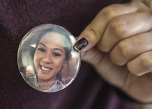 Katie Nguyen, shows off the pin she made of her stepsister…