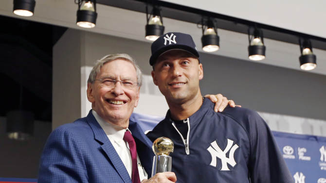 Major League Baseball Commissioner Bud Selig, left, poses for a picture with New York Yankees shortstop Derek Jeter after presenting Jeter with the Commissioner's Historic Achievement Award before a baseball game between the Yankees and the Baltimore Orioles at Yankee Stadium in New York, Tuesday, Sept. 23, 2014.  (AP Photo/Kathy Willens)