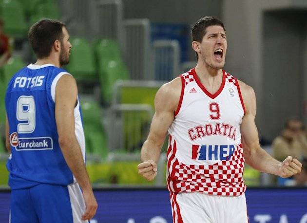 Croatia's Damjan Rudez (right) exclaims. (AP/Petr David Josek)