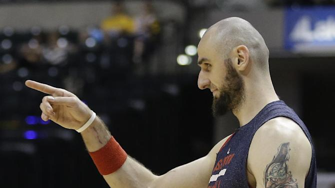 Washington Wizards' Marcin Gortat points toward his teammates as time expires in the second half of game 5 of the Eastern Conference semifinal NBA basketball playoff series against the Indiana Pacers Tuesday, May 13, 2014, in Indianapolis. Washington defeated Indiana 102-79