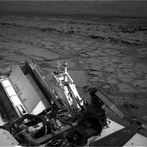 FILE - This Dec. 12, 2012 file image provided by NASA shows the Mars rover Curiosity at a pit stop, a shallow depression called &quot;Yellowknife Bay.&quot; It took the image on the 125th Martian day, or sol, of the mission (Dec. 12, 2012), just after finishing that sol&#39;s drive. The Sol 125 drive entered Yellowknife Bay and covered about 86 feet (26.1 meters). The descent into the basin crossed a step about 2 feet (half a meter) high, visible in the upper half of this image. Curiosity will now head for Mount Sharp in mid-February after it drills into its first rock. (AP Photo/NASA/JPL-Caltech, File)