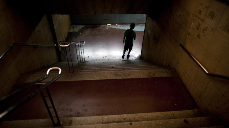 A man enters to an empty subway station during a nationwide 24-hour general strike in Buenos Aires, Argentina, Tuesday, Nov. 20, 2012. Argentine President Cristina Fernandez is facing a nationwide strike, led by union bosses who once were her most steadfast supporters. Many trains and bus lines are paralyzed; banks, courts and schools are closed; airlines have canceled flights and small groups of people have blocked highways in about a dozen places around the capital. (AP Photo/Natacha Pisarenko)