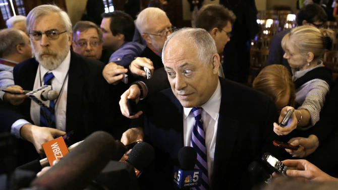 In this Jan. 8, 2013 photo, Illinois Gov. Pat Quinn is surrounded by reporters after testifying at a House committee hearing on pension reform at the Illinois State Capitol in Springfield Ill. Quinn suffered perhaps the worst fallout from this week's lame-duck session which ended with no action on the $96 billion problem, including his last-ditch effort to form a pension commission that wasn't even called for a vote. (AP Photo/Seth Perlman)