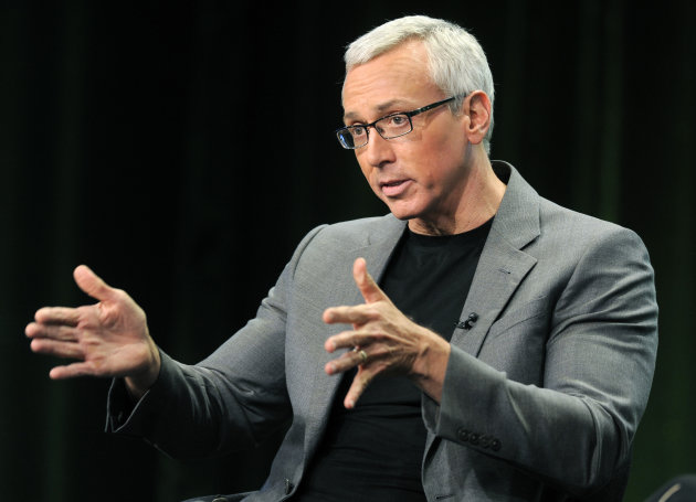 FILE - This Aug. 4, 2011 file photo shows Dr. Drew Pinsky, host of the CW television series &quot;Dr. Drew&#39;s Lifechangers,&quot; during a panel discussion on the show at the CW Showtime summer press tour in Beverly Hills, Calif. Criticism of Dr. Drew Pinsky spread on the Internet almost as quickly as news of Mindy McCready&#39;s death. The country singer with the tumultuous personal life became the fifth cast member of his &quot;Celebrity Rehab&quot; series to die since appearing on the show and the third from Season 3. (AP Photo/Chris Pizzello, file)