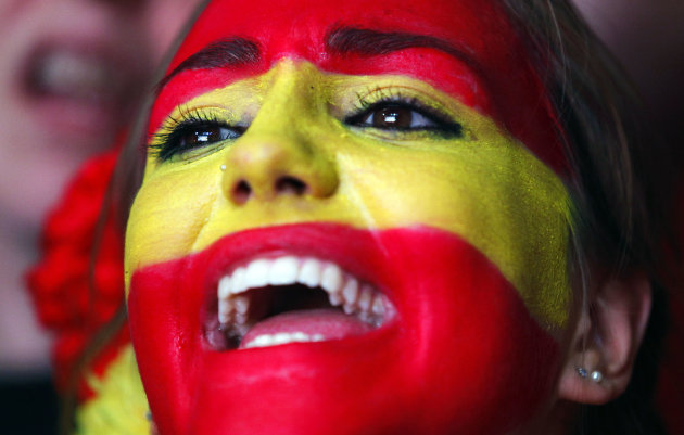 A Spanish fan reacts during the viewing of Euro 2012 soccer championship final match between Spain and Italy at the Fan Zone in Madrid, Spain, Sunday, July 1, 2012. (AP Photo/Andres Kudacki)