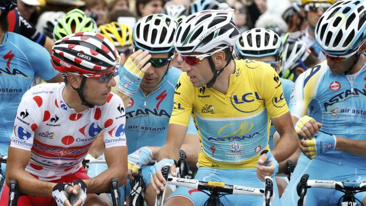 Race leader and yellow jersey holder Nibali speaks with best climber Rodriguez before the 237.5km16th stage of the Tour de France cycling race