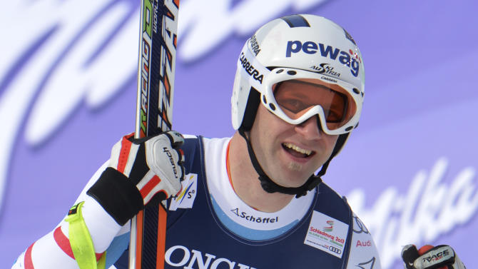 Austria's Romed Baumann smiles after the downhill run of the men's super-combined  at the Alpine skiing world championships in Schladming, Austria, Monday, Feb. 11, 2013. (AP Photo/Kerstin Joensson)
