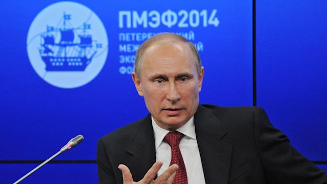 """Russian President Vladimir Putin speaks during a plenary session of the St. Petersburg International Investment Forum Friday, May 23, 2014. Putin said Friday at an investment forum that Russia will """"respect the choice of the Ukrainian people."""" He said that Russia wants peace and order to be restored in Ukraine. (AP Photo/RIA Novosti Kremlin, Mikhail Klimentyev, Presidential Press Service)"""