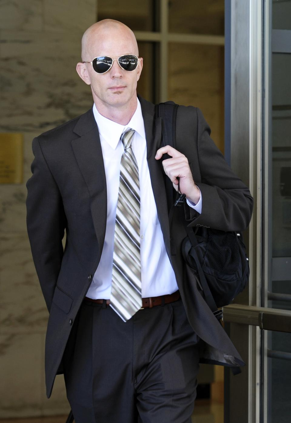 Jeff Novitzky, and agent for the Food and Drug Administration (FDA), exits federal court in Washington, Thursday, July 14, 2011, after a mistrial was declared in the government's perjury case against former Major League Baseball pitcher Roger Clemens. (AP Photo/Cliff Owen)