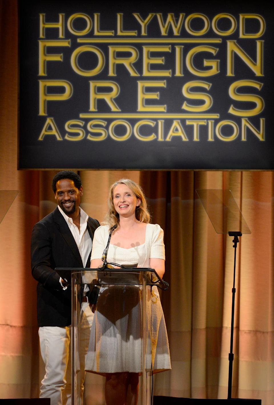 Blair Underwood, left, and Julie Delpy speak on stage at the Hollywood Foreign Press Association Luncheon at the Beverly Hilton Hotel on Tuesday, Aug. 13, 2013, in Beverly Hills, Calif. (Photo by Chris Pizzello/Invision/AP)