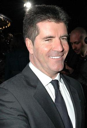 Simon Cowell Dating Carmen Electra? Other Celebs He's Been Linked To