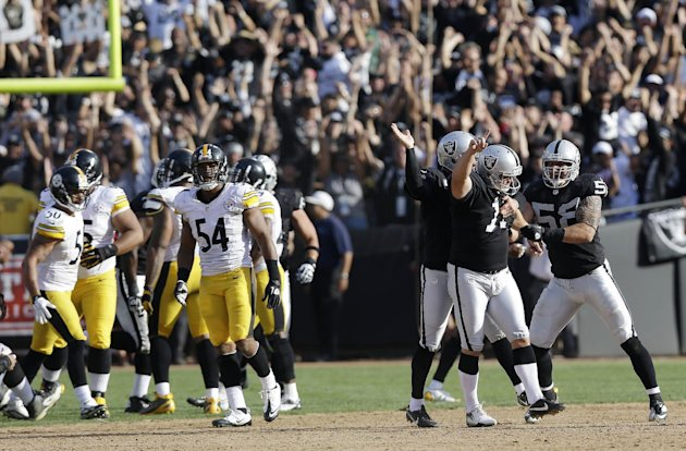 Oakland Raiders kicker Sebastian Janikowski, second from right, celebrates with teammates Dave Tollefson, right, and holder Shane Lechler, third from right, after kicking a 43-yard game-winning field goal during the fourth quarter of an NFL football game against the Pittsburgh Steelers in Oakland, Calif., Sunday, Sept. 23, 2012. At left are Steelers linebackers Larry Foote (50) and Chris Carter (54). Oakland won 34-31. (AP Photo/Marcio Jose Sanchez)